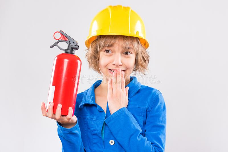 Girl with yellow hard hat stock photography