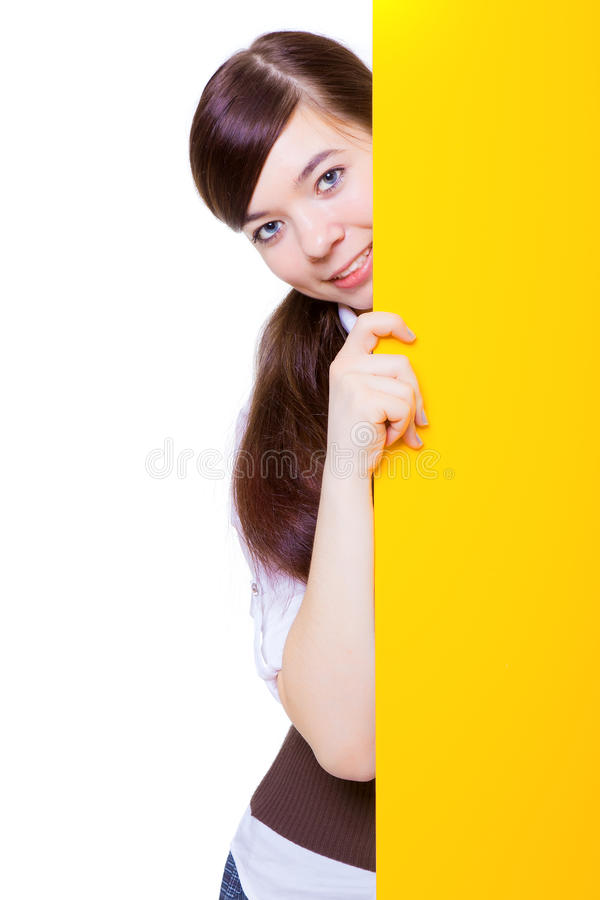 Girl and yellow poster. The smiling girl and yellow poster on white background royalty free stock images