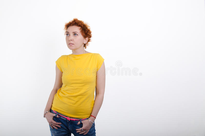 Girl in a yellow shirt royalty free stock photo