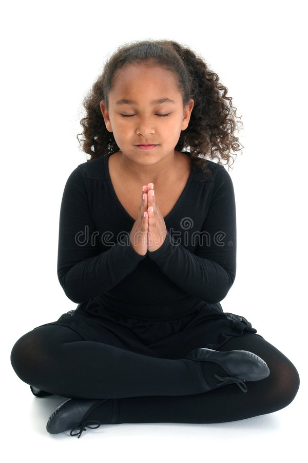 Girl in yoga pose. A young girl in a yoga pose stock images