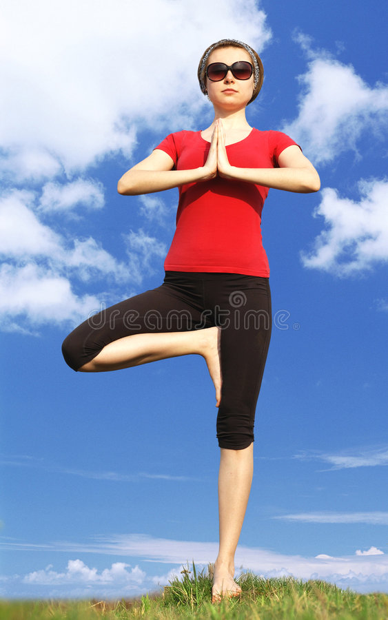 Girl in yoga pose royalty free stock photo