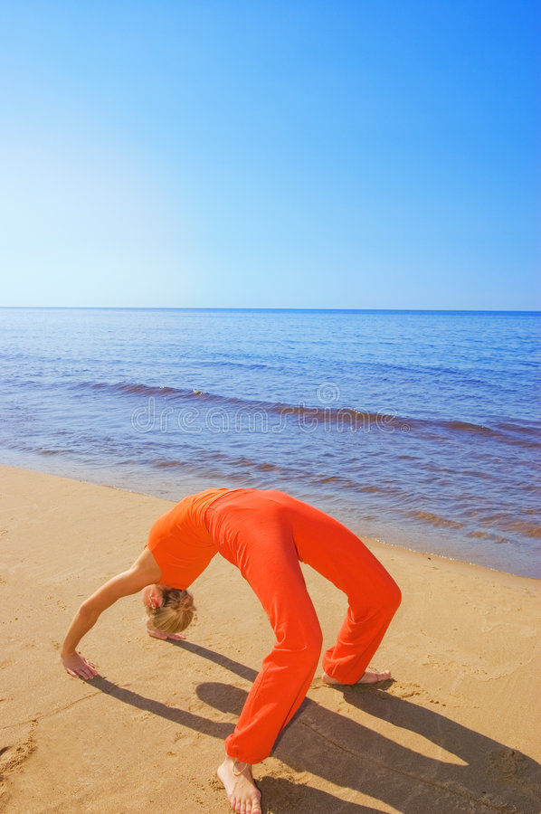 Girl in yoga position royalty free stock images