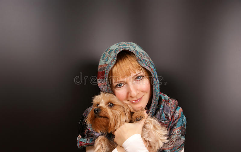Girl with a Yorkshire terrier stock images