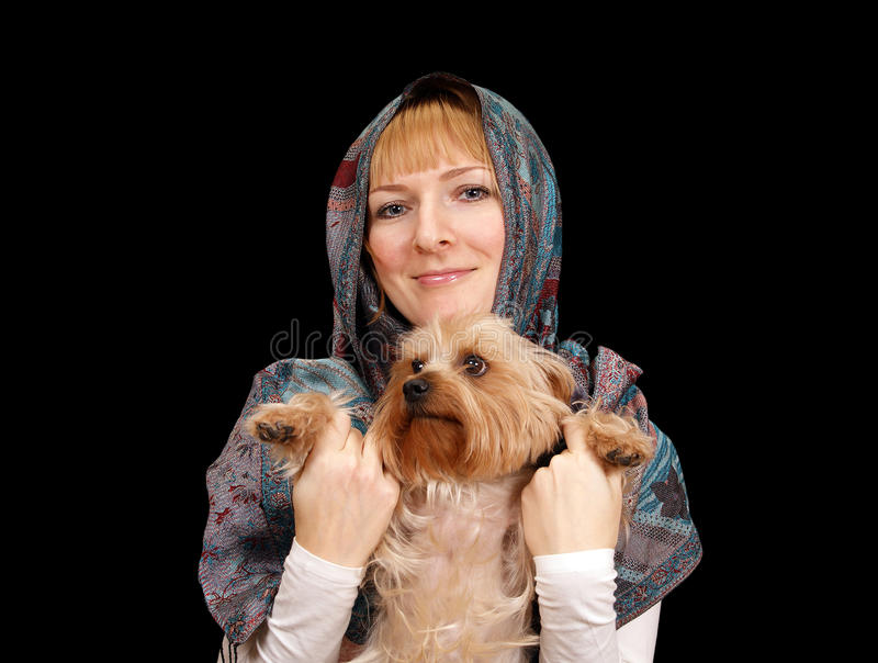 Girl with a Yorkshire terrier stock photo