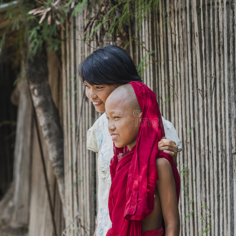 Girl and young monk royalty free stock photography
