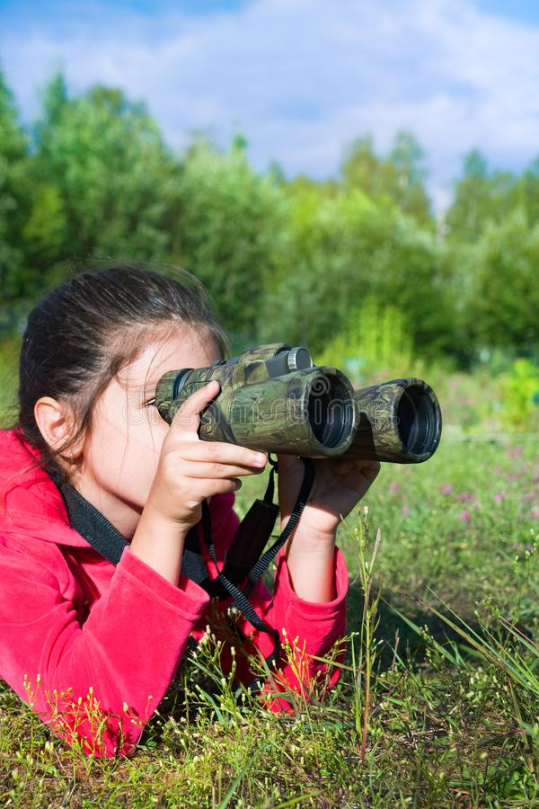 Girl young researcher exploring with binoculars environment stock photos