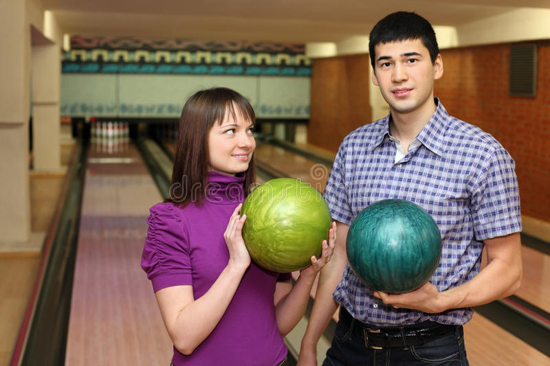 Download Girl And Youth Stand With Balls For Bowling Stock Image - Image: 20698923