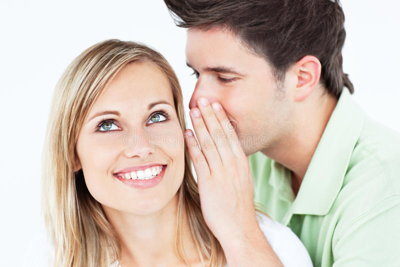 girldfriend hans man något till viska barn arkivfoton