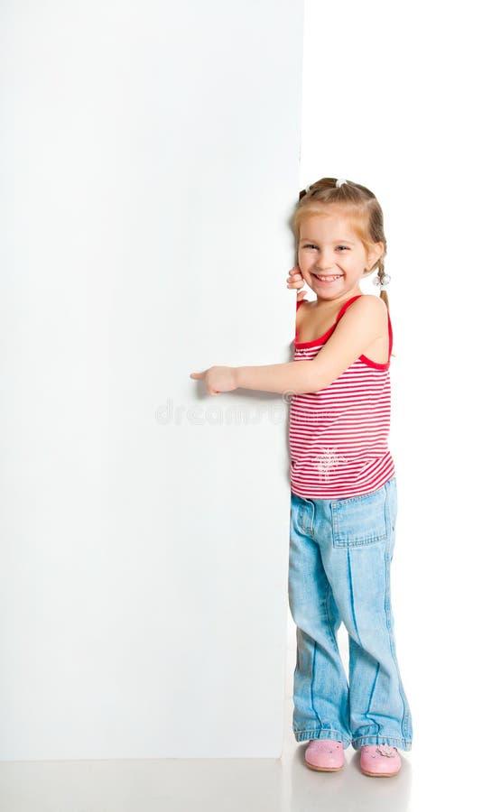 Girle naast een witte spatie royalty-vrije stock afbeeldingen