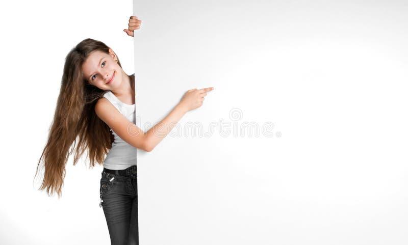 Girle naast een witte spatie royalty-vrije stock foto's
