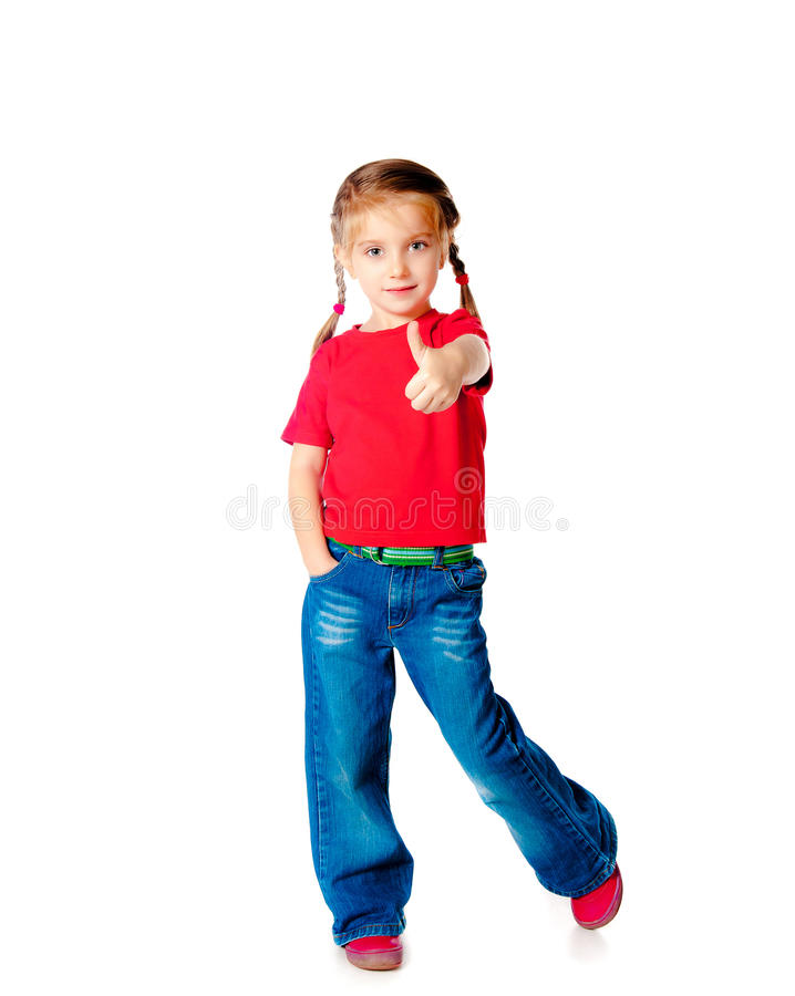 Girle showing a thumbs up. Positive little girle showing a thumbs up against white royalty free stock photography