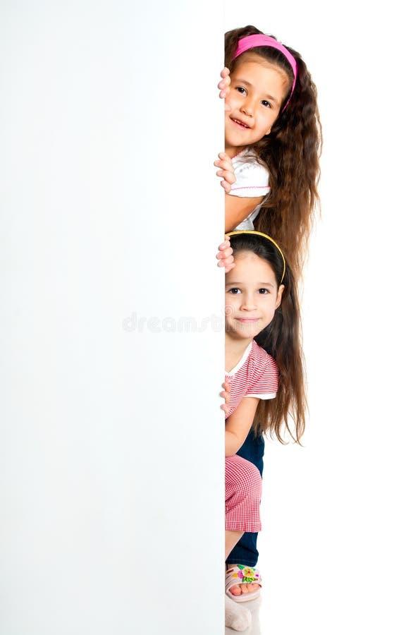 Girles naast een witte spatie stock afbeelding