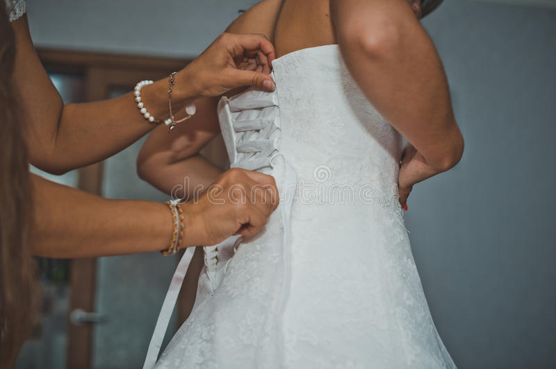 The girlfriend of the bride helps to dress a dress 1914. royalty free stock photos
