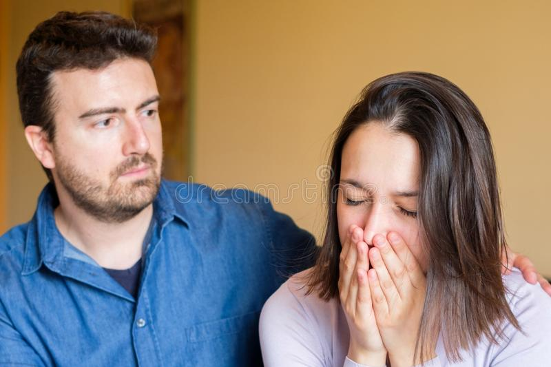 Girlfriend crying and boyfriend trying to make peace royalty free stock photography