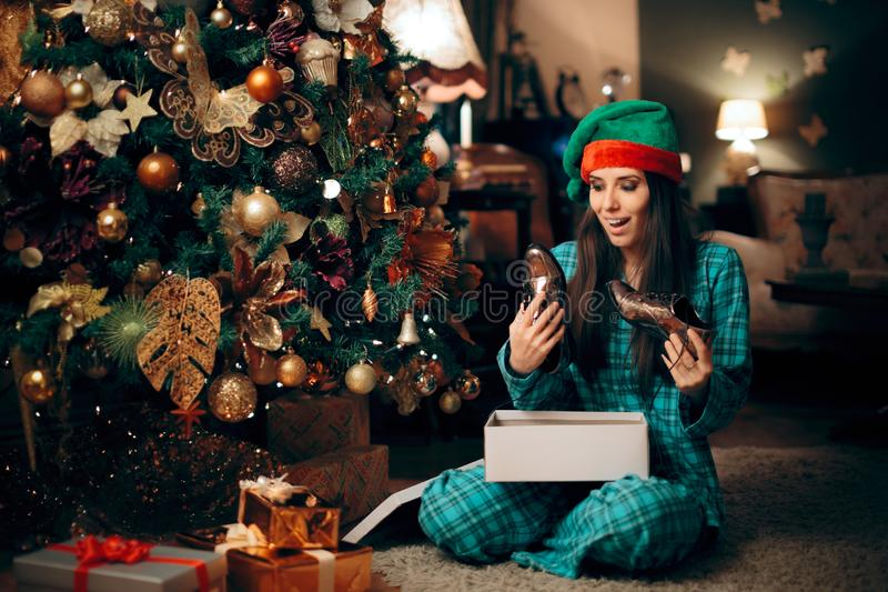 Happy Woman Receiving Silver Shoes for Christmas royalty free stock photos