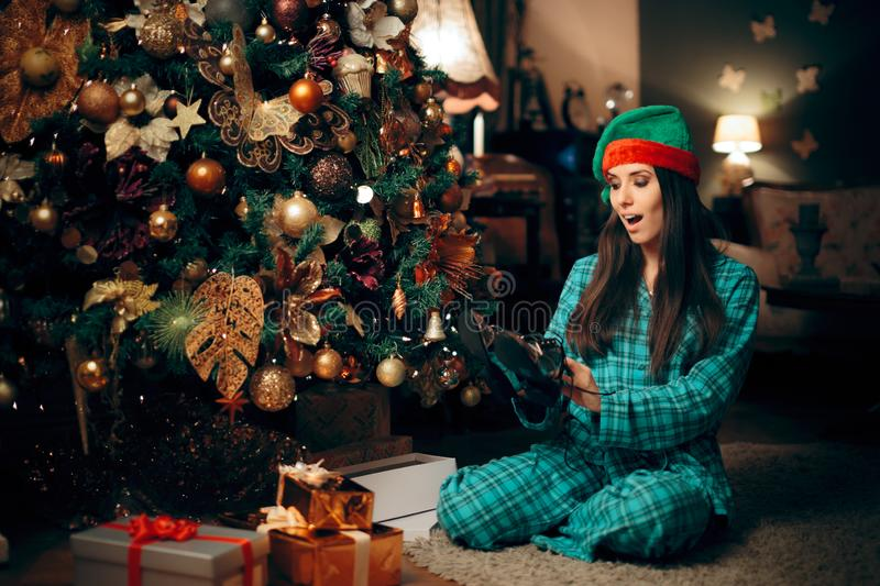 Happy Woman Receiving Silver Shoes for Christmas royalty free stock image