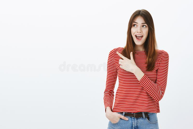 Girlfriend went on date to theme park, feeling awesome and excited. Pleased wondered attractive woman, looking up and royalty free stock photography