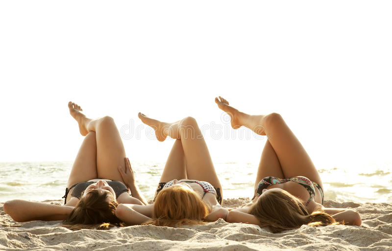 Girlfriends in bikini on the beach stock photo