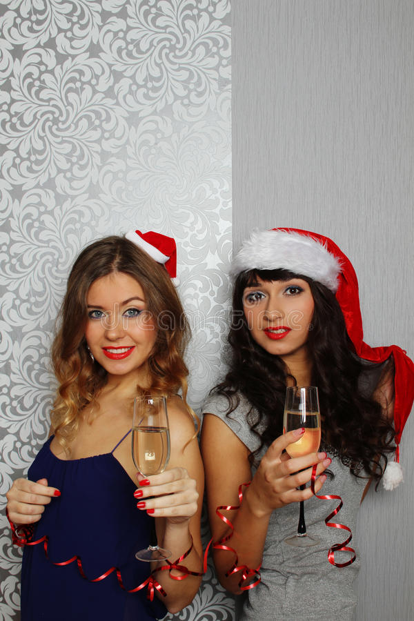 Girlfriends at christmas party stock images