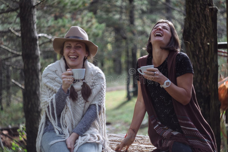 Girlfriends drinking coffee on nature in the country. Folk style.  stock photo