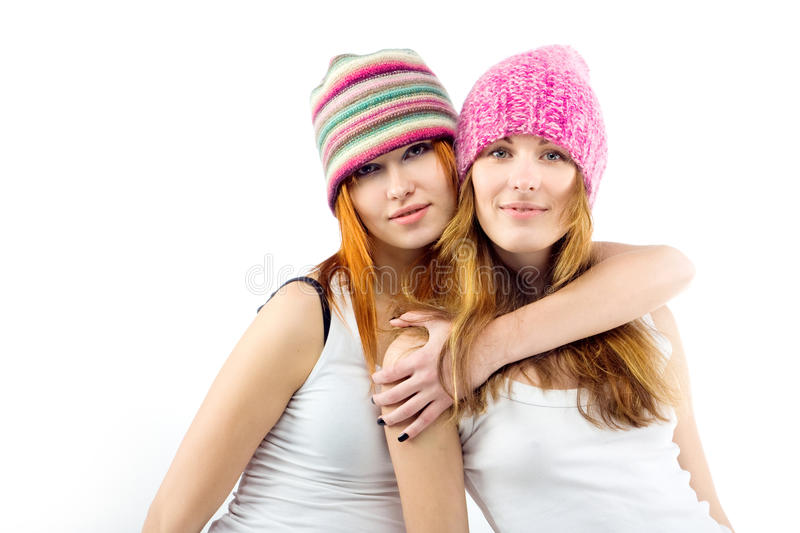 Girlfriends in embraces. Portrait of two girlfriends in embraces stock images