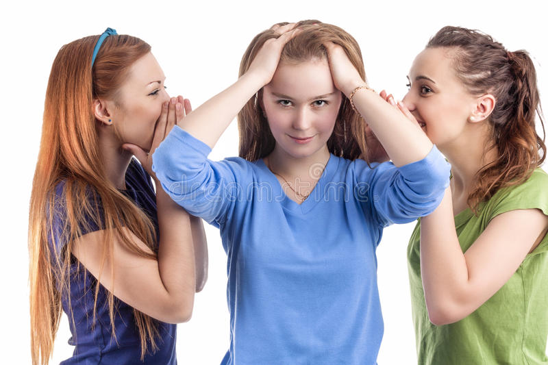 Girlfriends and Friendship Concept. Three Young caucasian Girlfriends Sharing Their Secrets Whispering to Ears. Isolated Over White Background royalty free stock photos