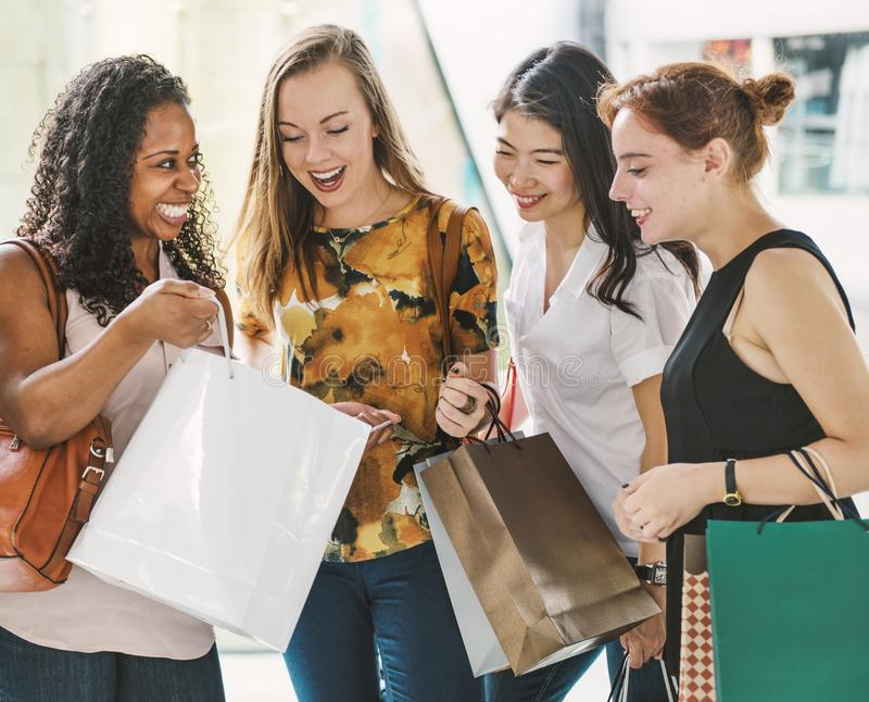 Girlfriends going shopping concept stock photo