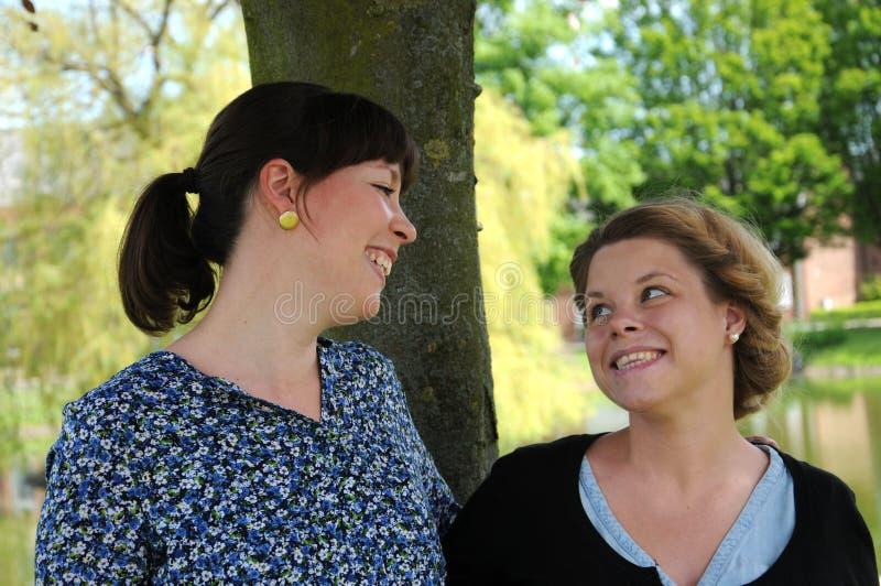 Girlfriends. Happy girlfriends sharing a moment of joy stock photo