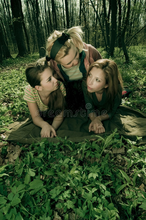 girlfriends relaxing in forest stock photos