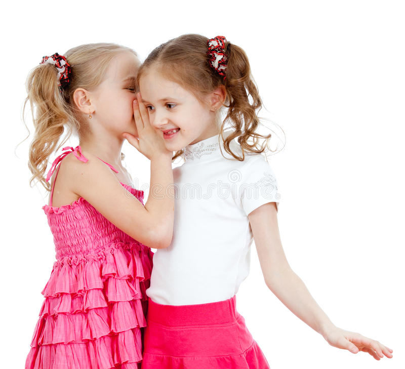 Girlfriends sharing a secret isolated on a white royalty free stock photos