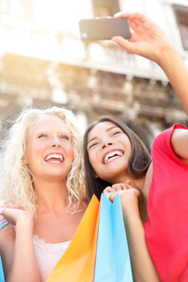 Girlfriends shopping laughing happy taking photo stock images