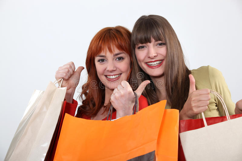Girlfriends shopping together royalty free stock image