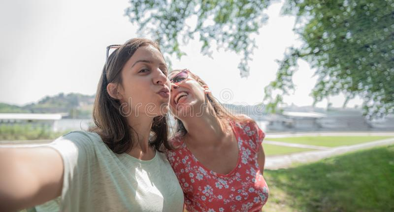 Girlfriends taking selfie together having fun outdoors concept of modern women friendship lifestyle best friends happy girls stock images