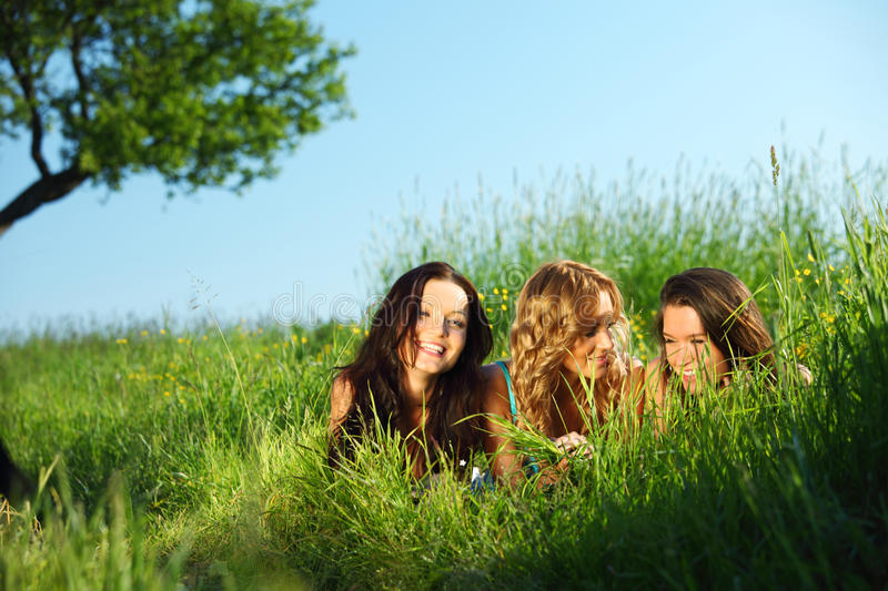 Girlfriends Under Tree Royalty Free Stock Images