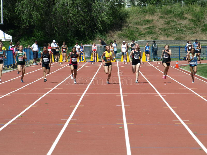 Girls on 100 meters dash. KELOWNA, CANADA - Wolczyc Brittni, Nicholson Ngahuia, Nijjar Gagandeep, Wilson Tegan, Heath Jenna, Silk Caitlin, Sinnatamby Tiana stock photos