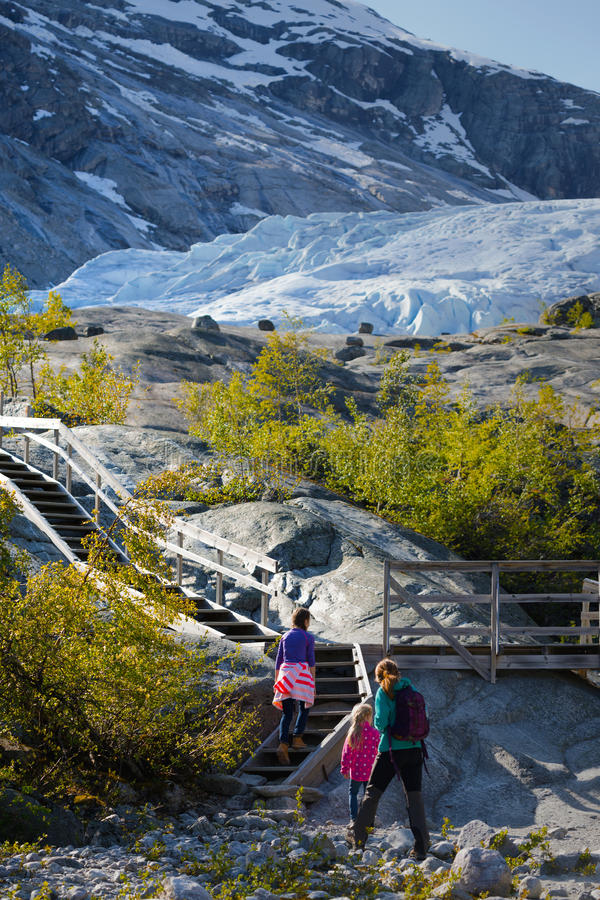 Girls against the backdrop of a glacier stock photo