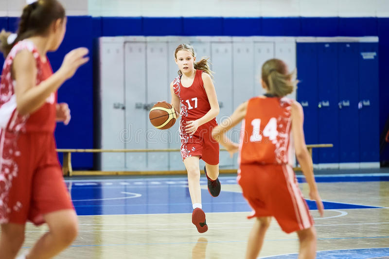 Girls athlete in sport uniform playing basketball. Indoors royalty free stock photos