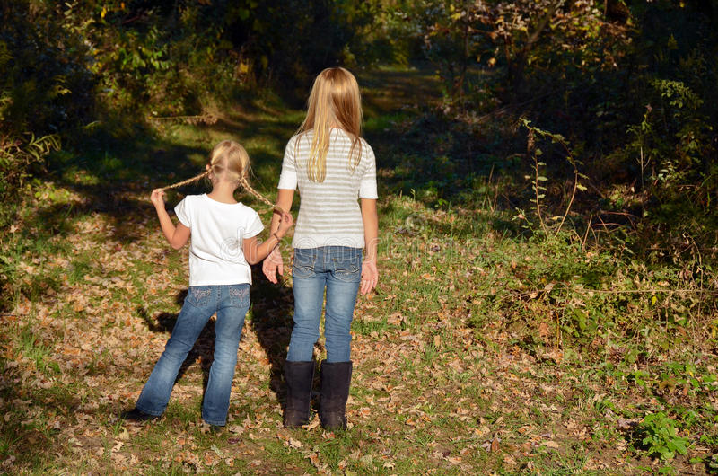 Girls In Autumn Woods Royalty Free Stock Images