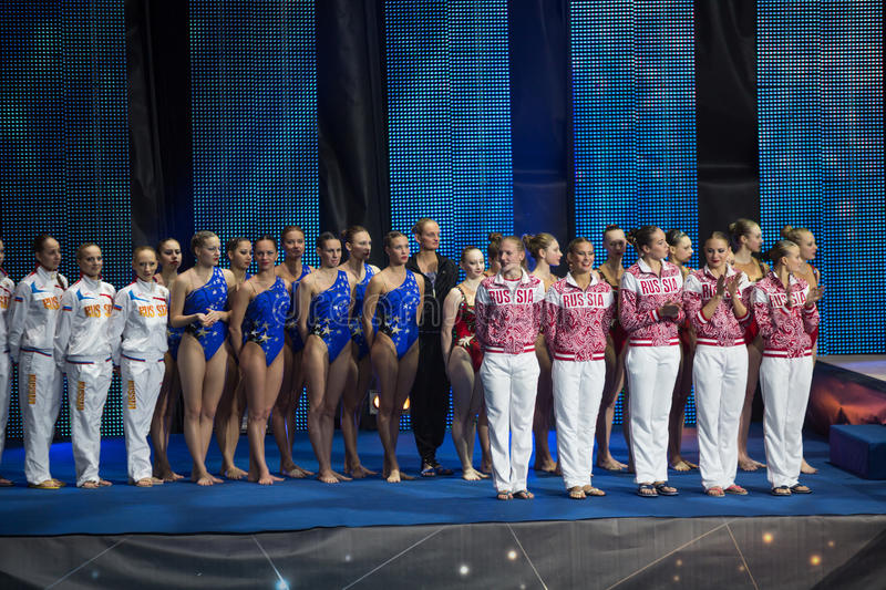 The girls on award ceremony of athletes at Show Olympic champions stock image