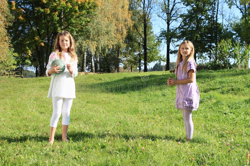Girls with a ball royalty free stock photo