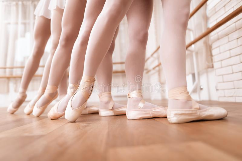 Girls ballet dancers rehearse in ballet class. They train dance moves. They use ballet barre. They are professional theater actors royalty free stock photos