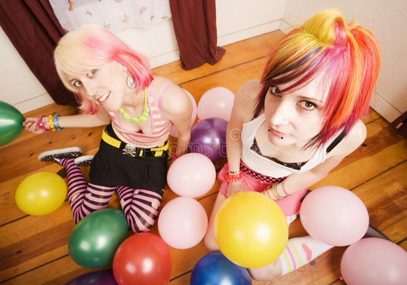 Girls With Balloons. Two punk girls in a room with colorful balloons stock images