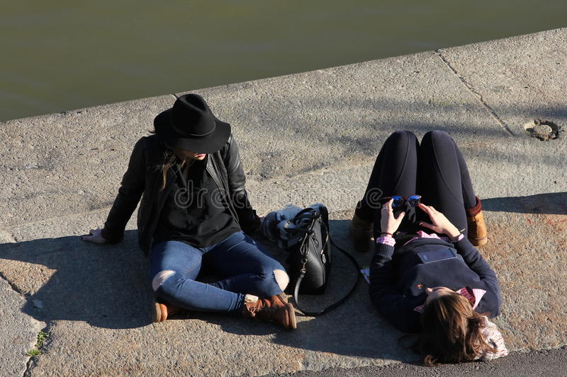 Girls on the bank of the Po river, Turin, Italy stock photo
