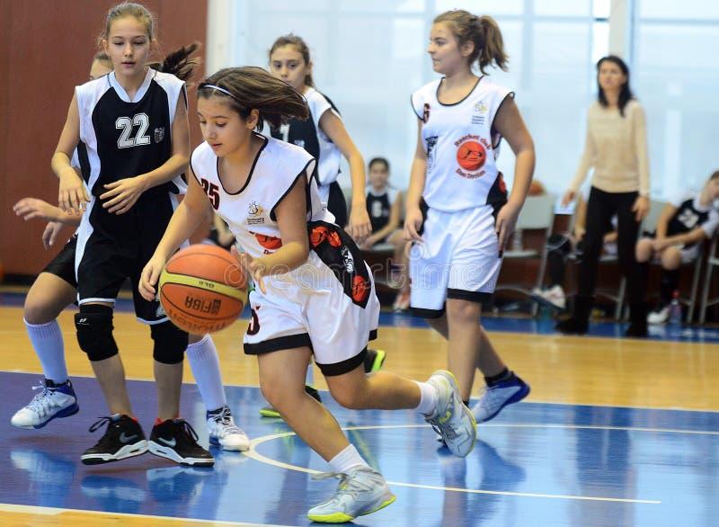 Girls basketball action. Basketball players pictured in action during Romanian Children National League game between Dan Dacian and CSM Bucharest. Dan Dacian won stock photography