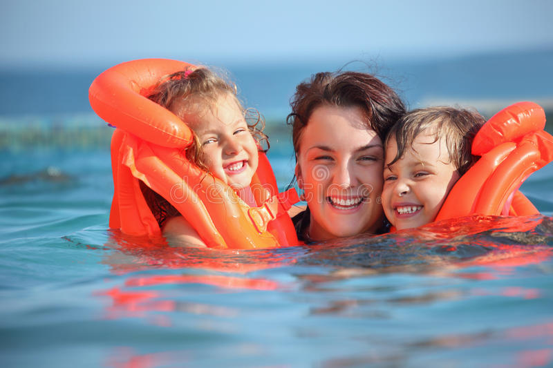 Download Girls Bathing In Lifejackets With Woman In Pool Stock Photo - Image of parent, female: 13021434