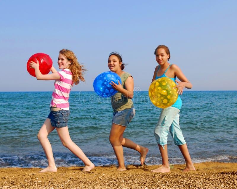 Girls on beach royalty free stock photos