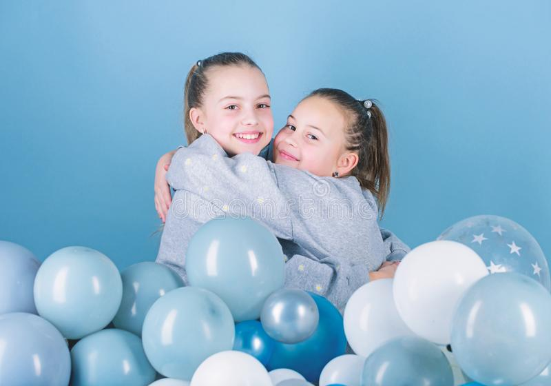 Girls best friends near air balloons. Birthday party. Happiness and cheerful moments. Carefree childhood. Start this stock images