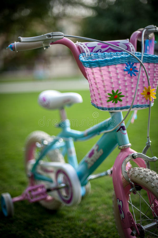 Girls bicycle royalty free stock photography