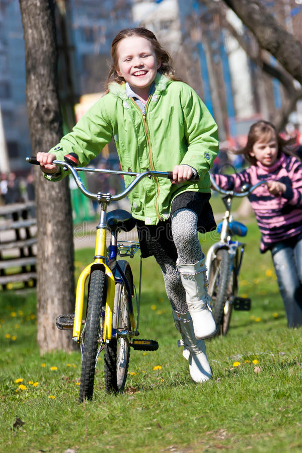 Girls with bicycles stock photos