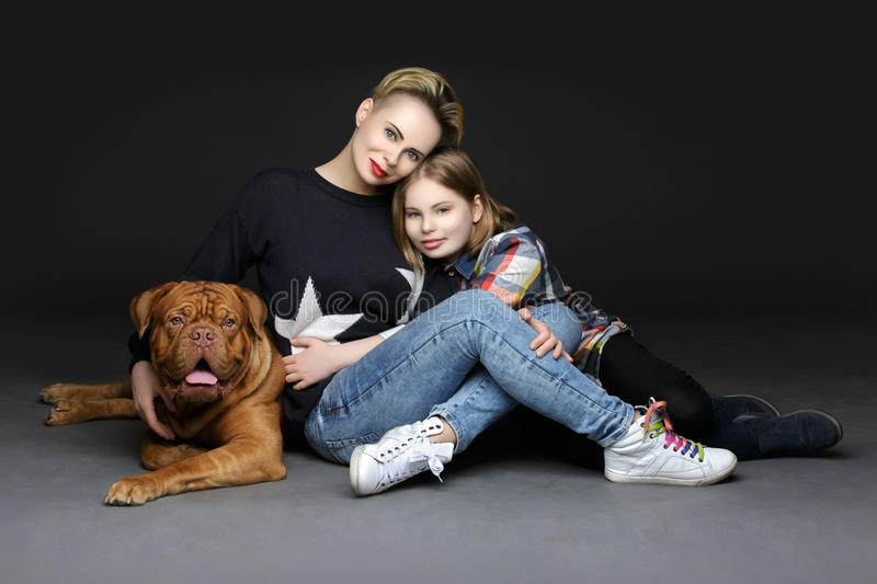 Girls with big brown dog stock photography